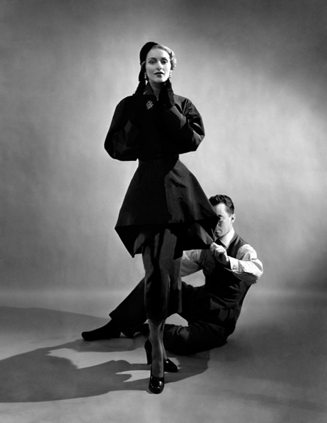 Designer Charles James pinning a suit on model (possibly Ricki V