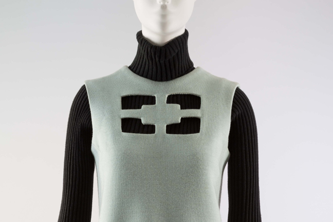 Aqua doubleface wool jersey dress with novelty cut out on chest.