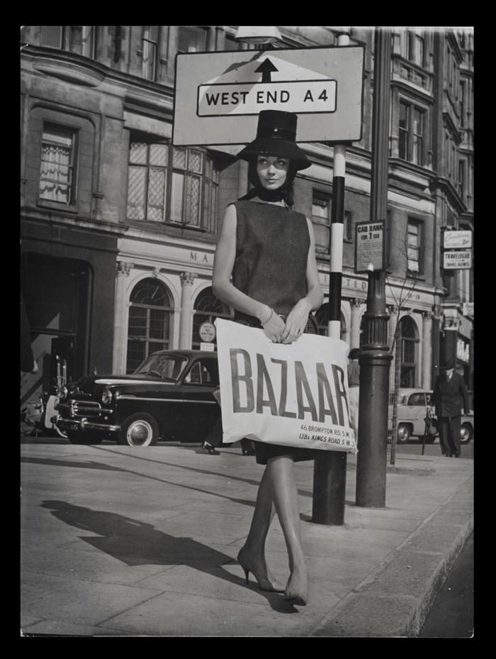 Model holding a Bazaar bag c.1959
